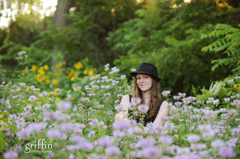 high school senior in field of purple flowers.