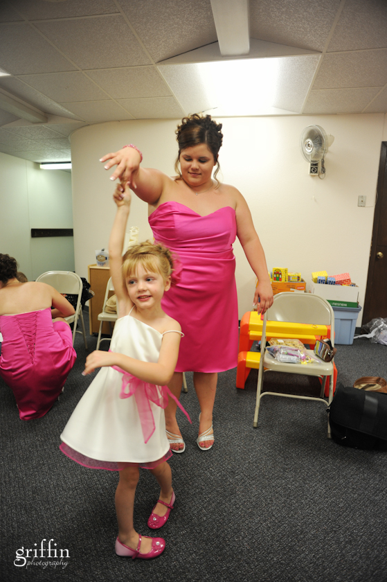 flower girl and bridesmaid dancing before the ceremony.
