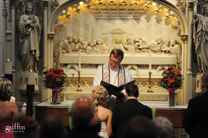 pastor reading from text during wedding ceremony.