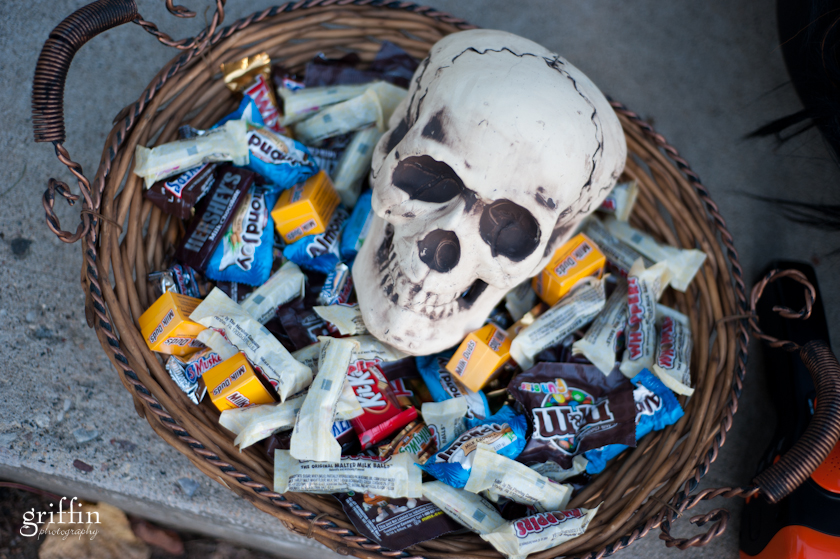 Candy surrounding skull for Halloween trick or treaters.
