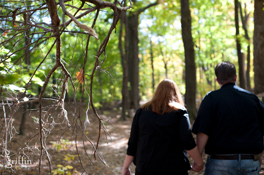 Bokeh of couple walking away holding hands on the trail at Pewitt's Nest, Baraboo.