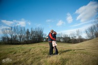 Affianced couple kissing for Griffin Photography.