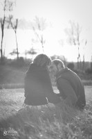Griffin Photography, Madison engagement photographers, capture couple sitting in grass.