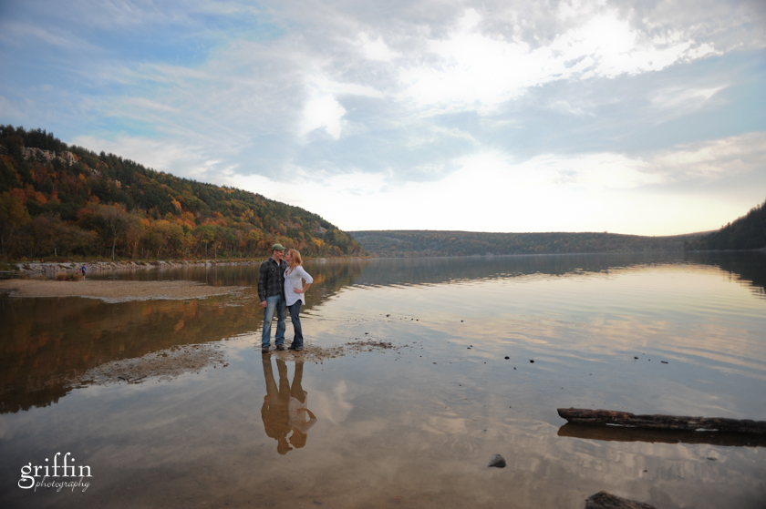 Couple reflected in the clear waters of Devil's Lake.