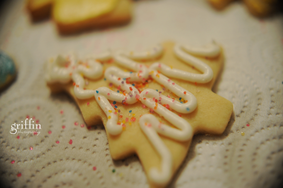 Chrstmas tree cutout sugar cookie with colorful sprinkles.