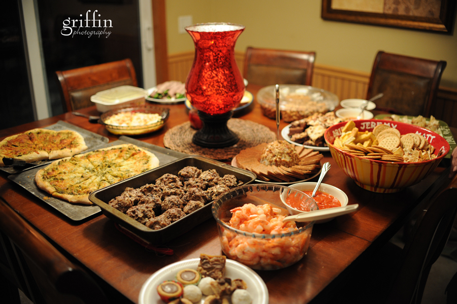 Appetizers after church laid out on the table with stuffed mushrooms, baked brie, shrimp and pesto pizza.