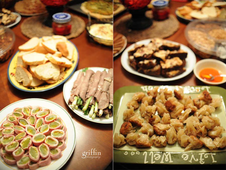 Pickle roll ups, homemade bread, potstickers and assorted delicous appetizer spread.
