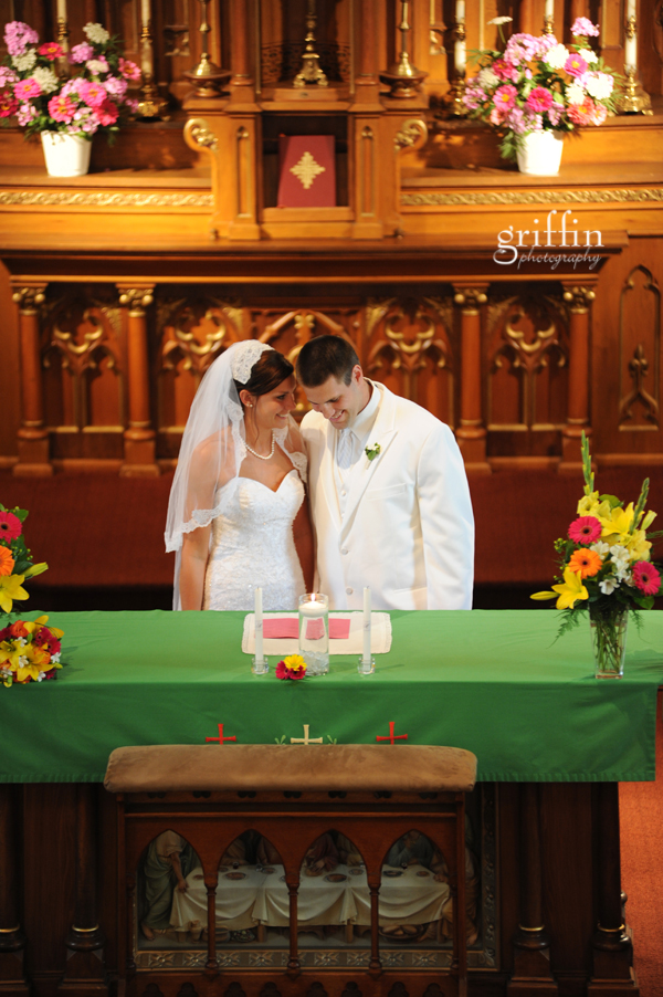 Griffin photography captures the bride and groom whispering during the ceremony.