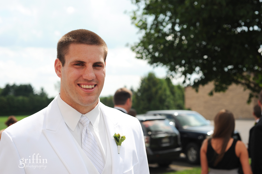 The handsome groom smiling for Griffin Photography.