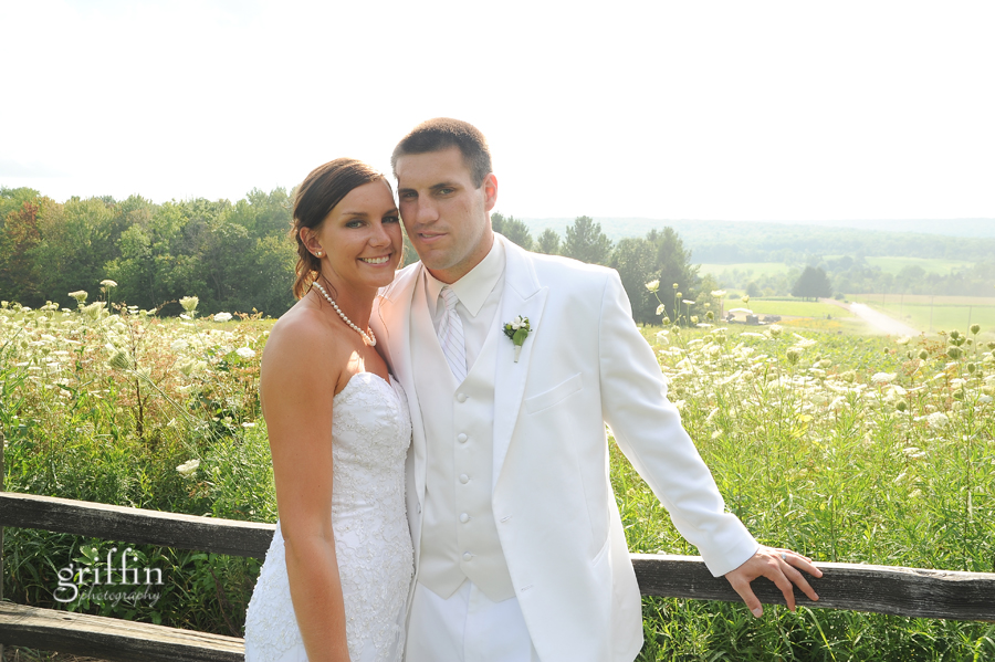 Griffin photography wisconsin wedding photographer captures bride and groom in front of rolling Wisconsin hills.