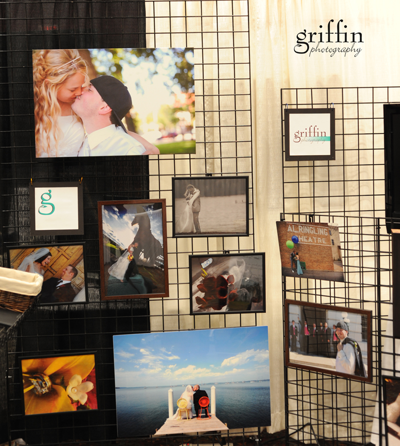 Close up of images hanging on the back wall of our bridal fair booth.