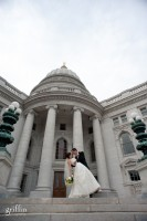 Bride and groom dipping on capital building steps, Griffin Photography wedding photographers.