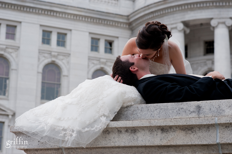 Bride and groom kissing at the state capital in Madison.