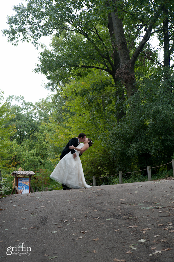 Bride and groom kissing at Henry Vilas Zoo in Madison.