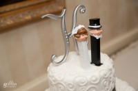 Bride and groom pez dispensers on top of the cake.