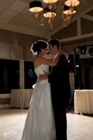 Bride and groom backlit during the first dance.