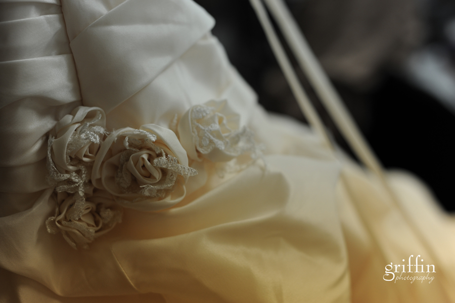 Flower detail on cream wedding dress with lace.