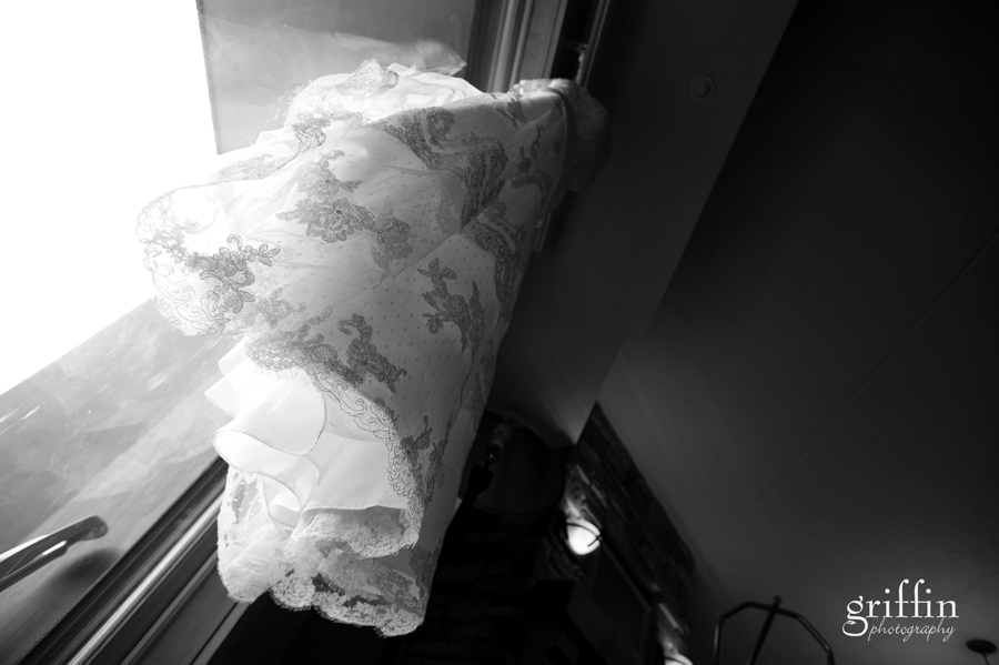 Lacy wedding gown hanging from curtain rack at Chula Vista, Wisconsin Dells.