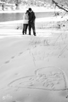 Love heart in the snow with the engaged couple's names inside.