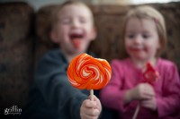Giant whirly pop with sticky faced kids captured by Griffin Photography Wisconsin lifestyle photographer.