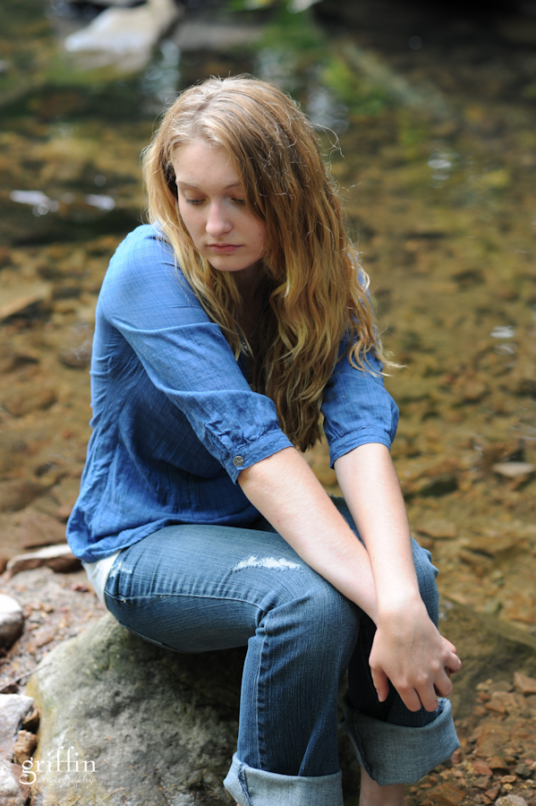 Senior portrait in creek.
