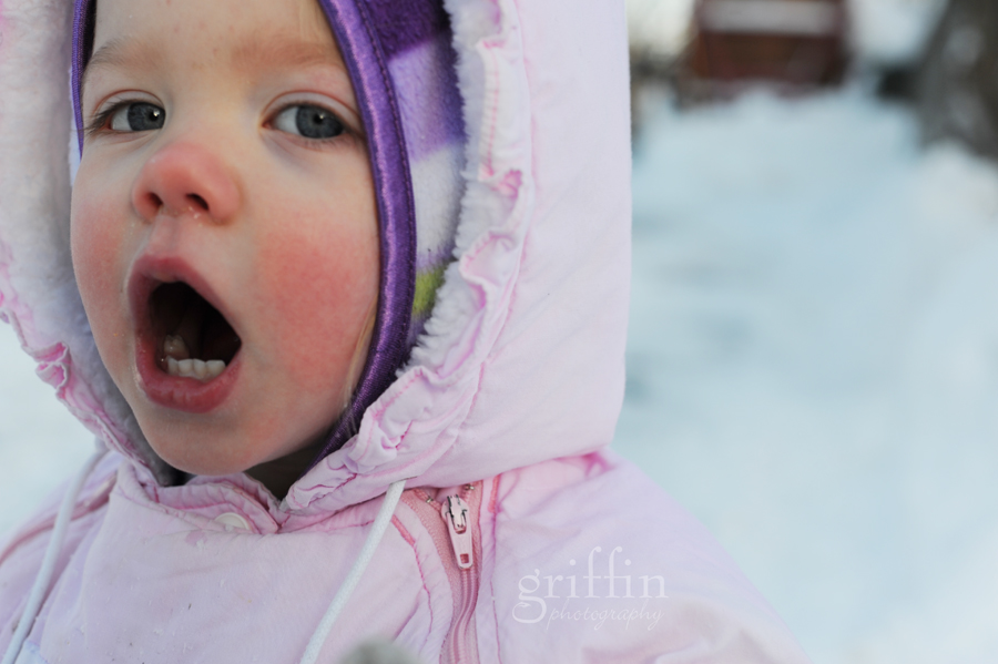 wisconsin lifestyle photographer captures child in snowsuit.
