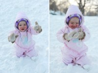 Child crying because she is stuck in a deep mound of snow.