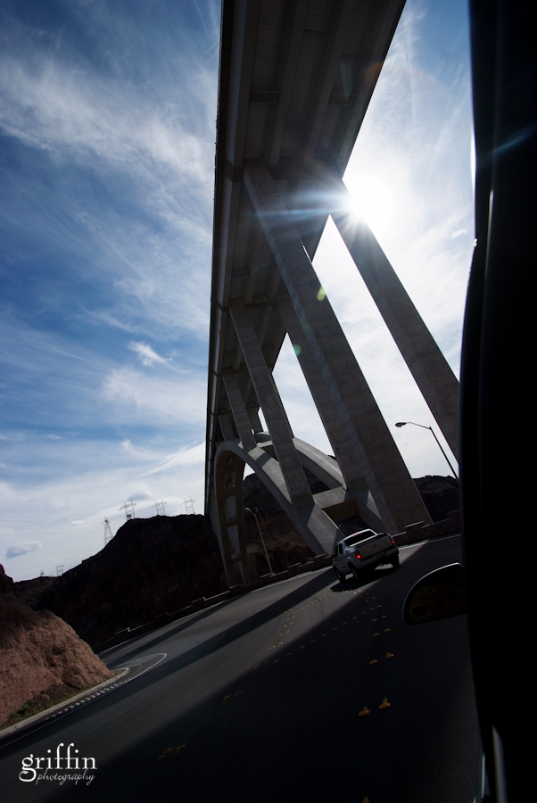 Sun flare coming through the Colorado River bridge near the Hoover Dam.