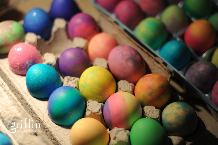 Multicolored dyed Easter eggs waiting to be hidden.