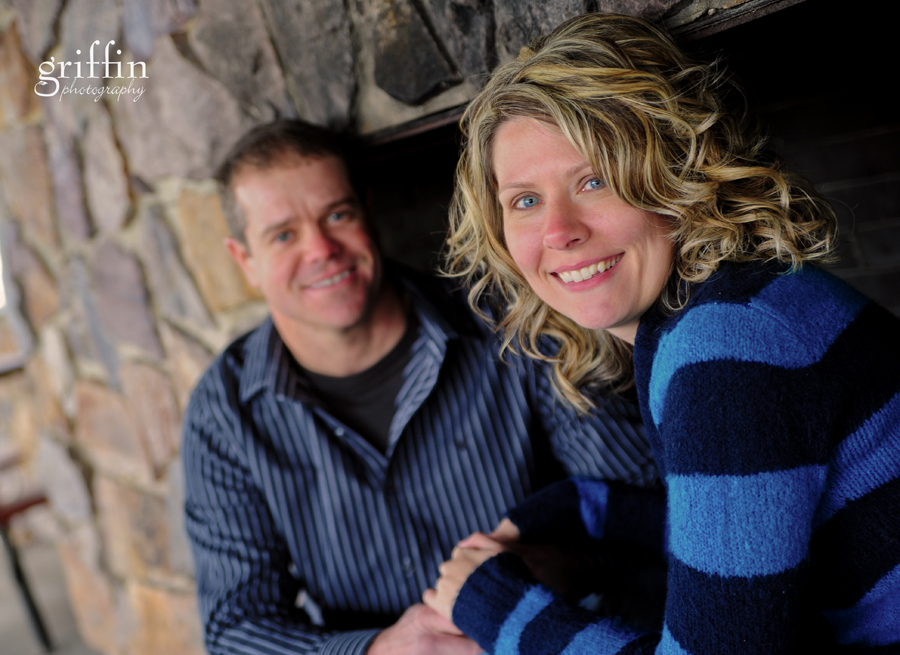 Sitting inside a giant stone fireplace during the engagement session.
