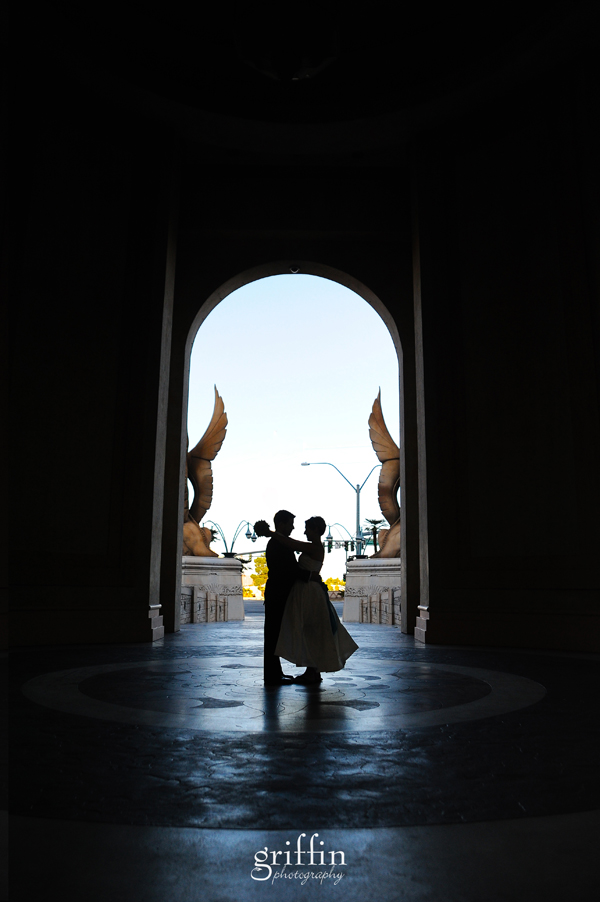 Bride and groom silhouetted in archway in front of the Mandalay Bay, Las Vegas.