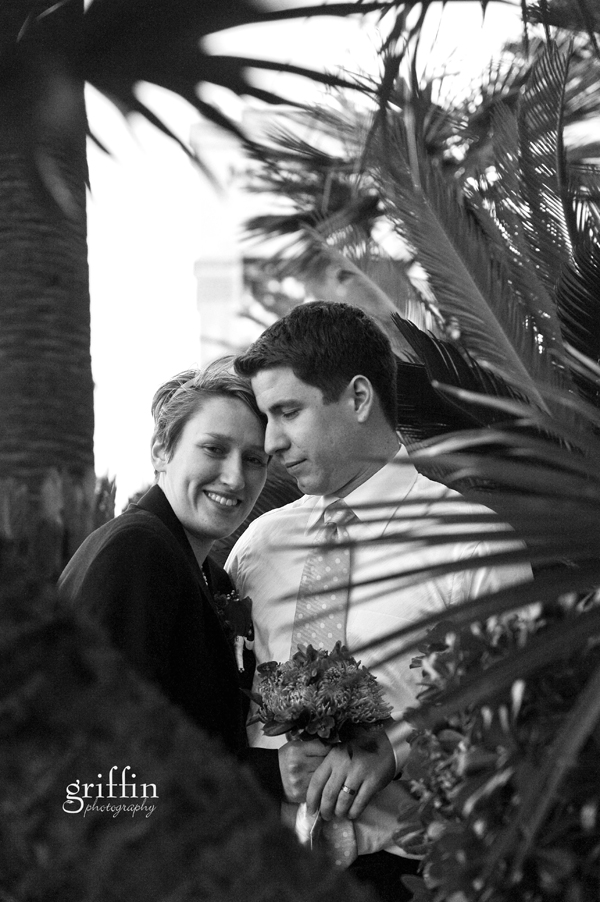 Black and white of married couple holding each other.
