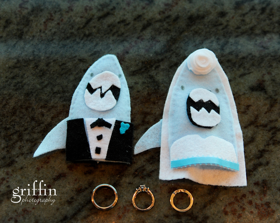 Wedding rings and shark puppets.