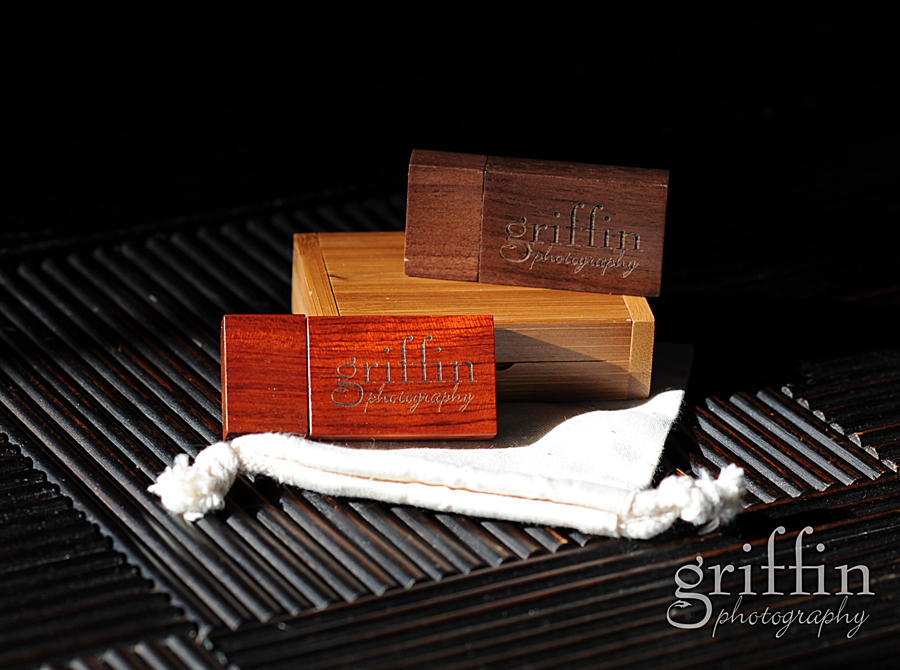 Wooden flash drive assortment with Griffin photography logo.