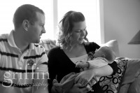 Documentary newborn photography family on couch.