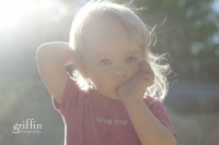 Toddler with sun highlighting her blonde hair.