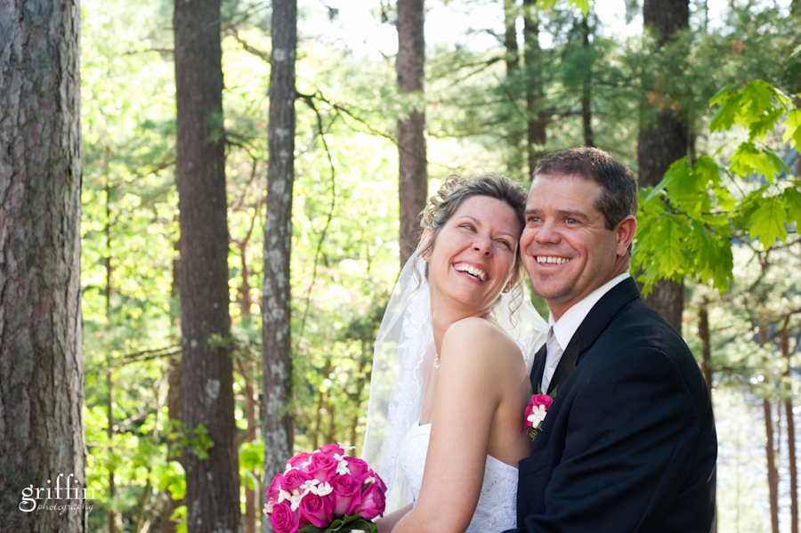 Bride and groom in front of trees at the Chula Vista Resort in Wisconsin Dells.