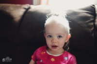 Toddler with hair up in a ponytail.
