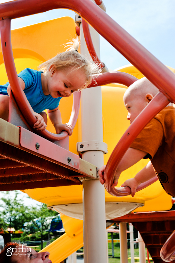 Toddlers climbing on playground equipment in the Dells.