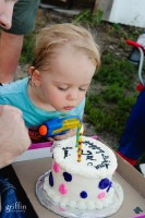 Two year old blowing out the candles.