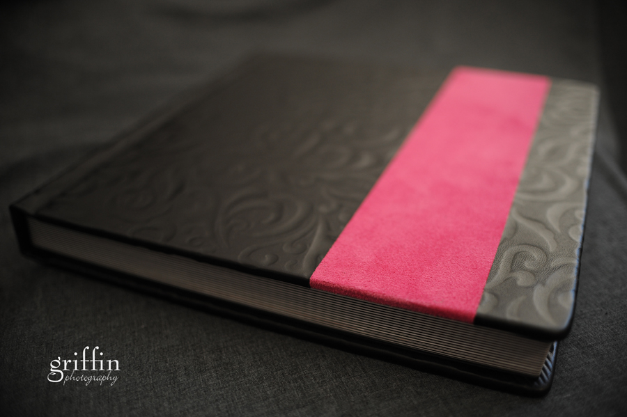 Hot pink suede and black leather Finao wedding album from Griffin Photography.
