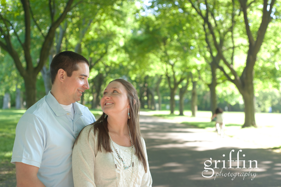 Engagement session in tree lined drive, Milwaukee.