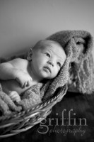 Black and white of newborn in basket.