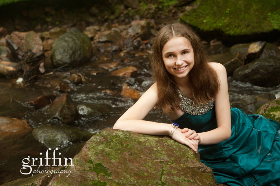 Senior girl in creek for senior photos.