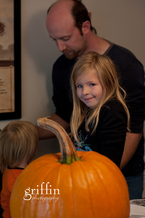 A shy little grin with the pumkins.