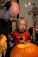 Showing the girls the innards of a pumkin.