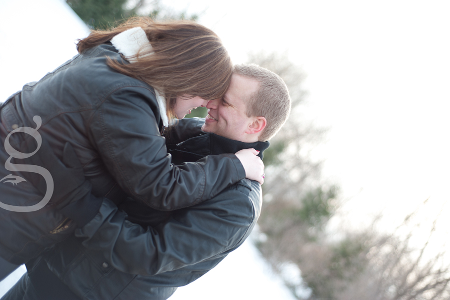 Couple kissing in the snow.