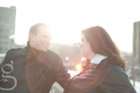 Sunflare between the engaged couple on the Madison capital stairs.