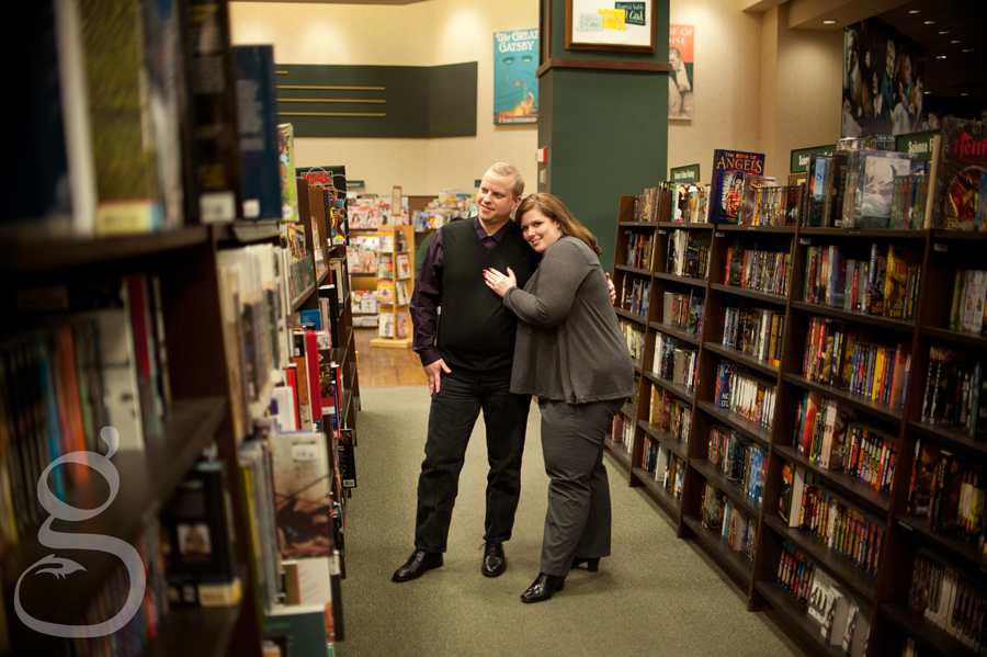 Engaged couple in the sci-fi aisle at Barnes and Noble.