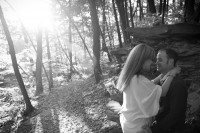 Sun streaming through trees at the engagement session in Baraboo.